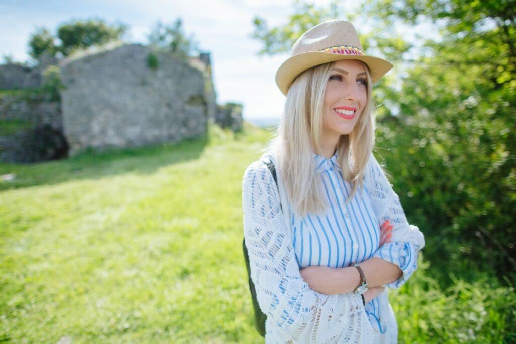 rtrait of joyful female traveler
